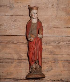 Sankta Katarina av Alexandria. Medeltida träfigur som stals ur Tidersrums kyrka hösten 2010. Senare återbördad.